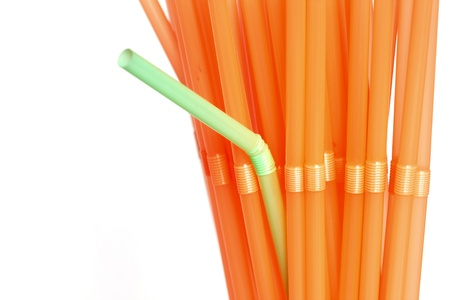 Dare To be different - green straw among orange ones