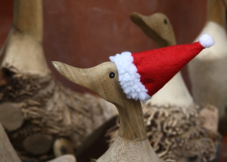 A wooden duck with Santa Claus Cap photo