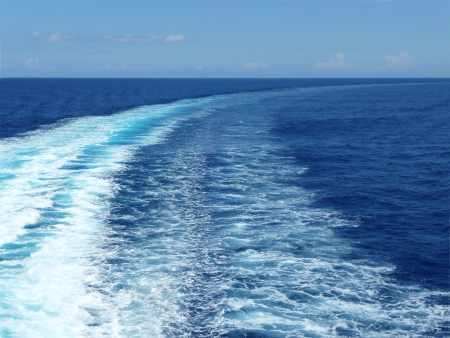 Wave traces on the blue ocean surface with copy space