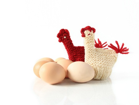 Egg Warmer in shape of knitted hens, isolated Stock Photo - 19050332