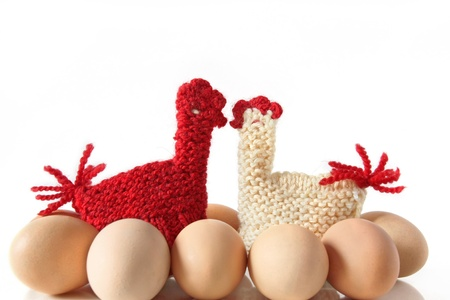 Egg Warmers in shape of knitted kissing hens, isolated Stock Photo - 19050338