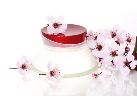 Cosmetics with cherry flowers photo