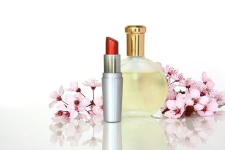 Perfume and Lipstick with Sakura flower Stock Photo - 19125637
