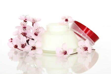 Cosmetics with cherry flowers Stock Photo - 19125636