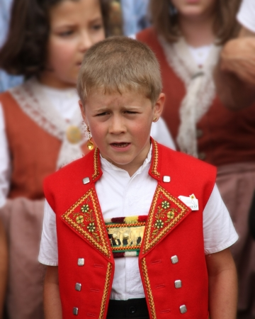 SCHAFFHAUSEN, SWITZERLAND - JULY 3  2011  A boy, in traditional Swiss costume, is yodeling at the 27th North-West Switzerland Yodeling Festival