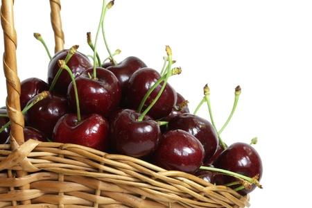 Basket of fresh cherries, isolated