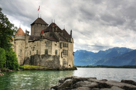 chillon: Montreaux, Switzerland, July 26.2011: Chillon Castle, which was built in 12th century, in a stormy day Editorial