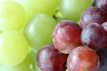 Macro of green and red grapes