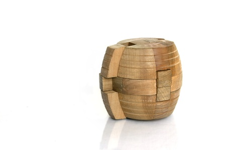 disassemble: A cylindrical wooden puzzle with part out of the block