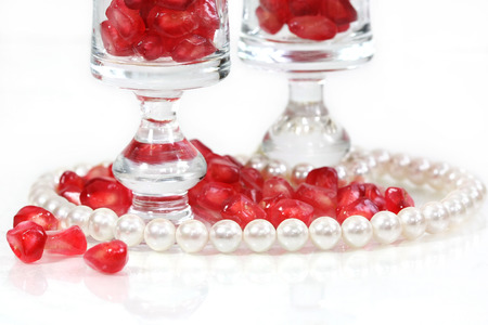 pearl bracelet with red pomegranate seeds photo