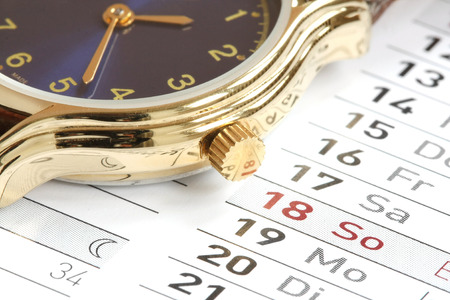 Wrist watch on the calendar  Stock Photo