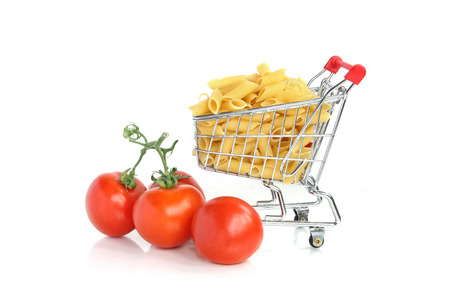 Pasta in mini shopping cart with tomatoes
