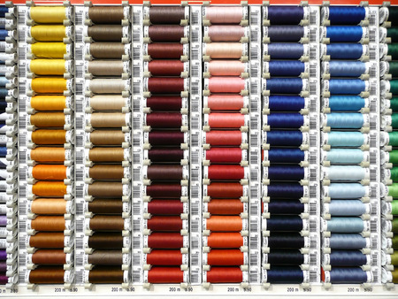 sewing box: Colorful Sewing thread rolls Stock Photo