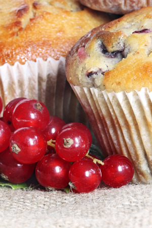 Red currant muffin on linen background (manual focus)