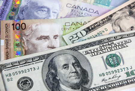 Canadian dollars vs. US dollars, which are important for board trading (manual focus) Stock Photo