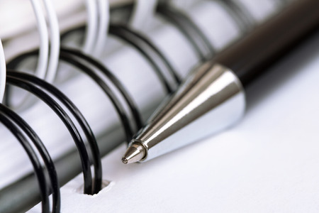 close   up: Ball pen and office pad (manual focus on the pen tip Stock Photo