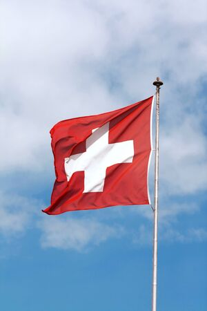 Swiss flag swinging in the air