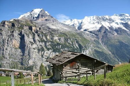 A traditional wooden hut under the foot of the Alps in Switzerland Stock fotó