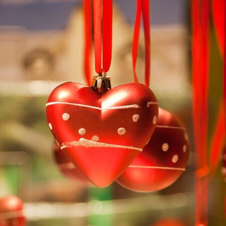 Heart shape Christmas balls in shopping windows