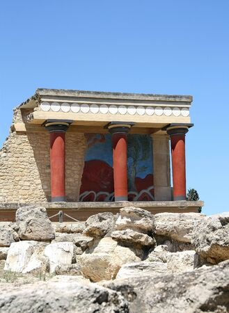 Heraklion, Greece - May 20, 2010: Fresco of bull and classical Minoan column at the archaeological Site of Knossos Palace, which dates to 1900 BC , Crete Island, Greece