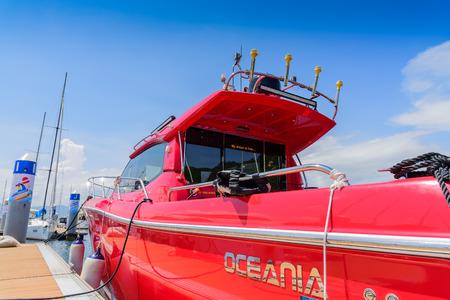 ruder: Sailboat parking at the side of a platform Editorial