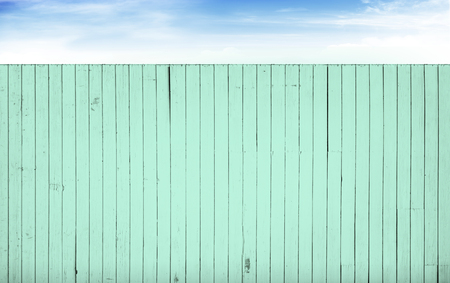 turquoise color wooden fence & blue sky white clouds background