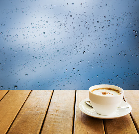 brea: cup coffee and Bokeh water drops  background