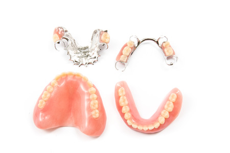 denture: removable partial denture on white background.