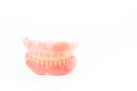 prosthetic equipment: complte denture on white background Stock Photo