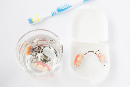 high cost of healthcare: Dental hygiene and cleanliness concept with a toothbrush