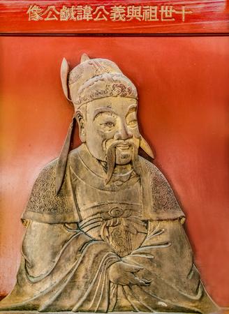 ancestor carving on wall Stockfoto - 109299906