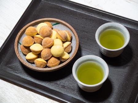 sencha tea: Tea and sweets Stock Photo