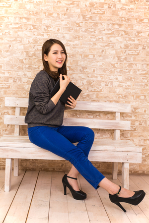 Woman with a Tablet Stock Photo
