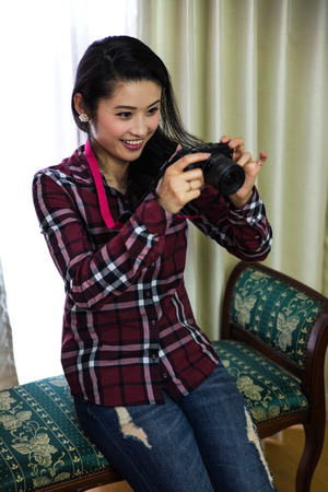 A woman with a camera Stock Photo
