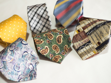 Tie in various patterns and colours
