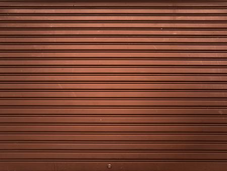 shutter door: Brown metallic roller shutter door for background Stock Photo
