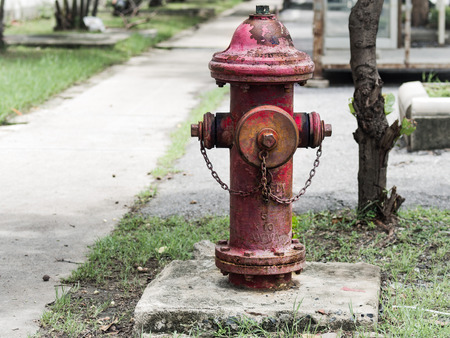 Vintage Red Fire Hydrant on a concrete base