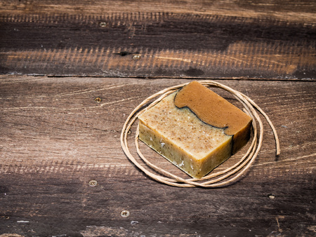 Natural soap bars on old wooden background Banco de Imagens