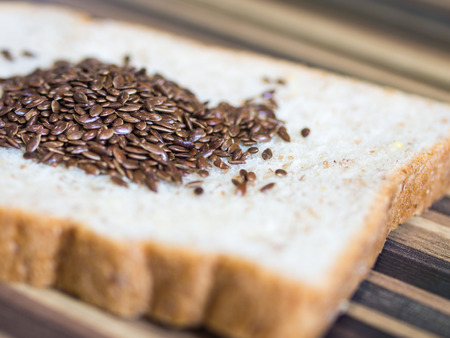 Flax seeds on slices of freshly baked