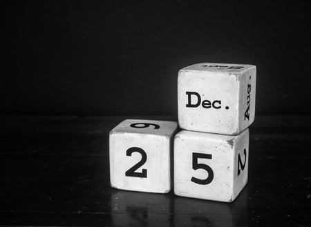 25 DEC.Merry christmas with white wooden cube calendar.black  white