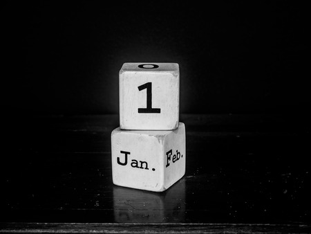 1st January Happy new year with white wooden cube calendar -black  white