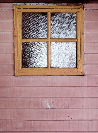 old vintage window on the pink wood wall