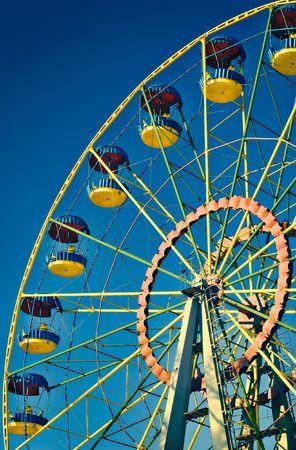 Ferris wheel on blue sky in amusement park Stock Photo - 4664436