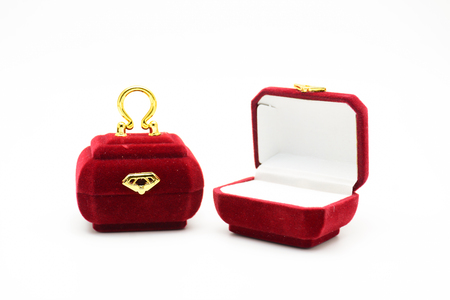 Red velvet box for the ring, fancy ring box, isolated over the white background. Mini red purse ring box.