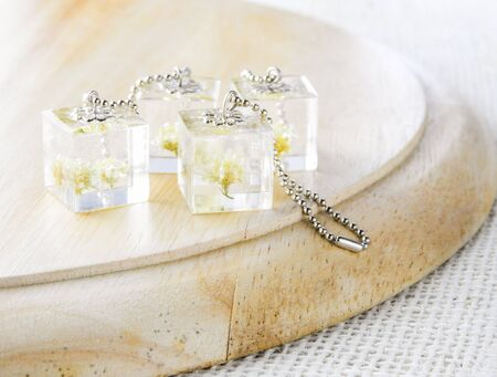 Dried flower in crystal clear resin pendant necklace, pendant with a real flowers. Reklamní fotografie
