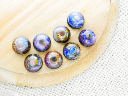 Create galaxy drink coasters using resin, glitter and pigment powders, handmade items. Suitable for keychains, necklace and pendant.