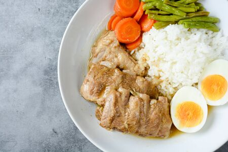 Baked pork ribs with rice, boiled egg and vegetable Stock fotó