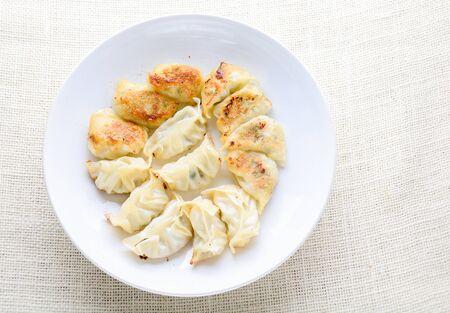 Japanese Fried Dumplings, the half moon-shaped dumplings served in Asian restaurants as an appetiser or side dish, pork and vegetable filling.