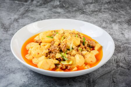 Mapo Tofu, popular Chinese dish.  The classic recipe consists of silken tofu, ground pork or beef and Sichuan peppercorn to name a few main ingredients. 写真素材 - 129689299