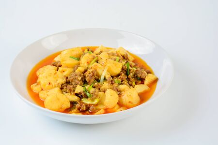Mapo Tofu, popular Chinese dish.  The classic recipe consists of silken tofu, ground pork or beef and Sichuan peppercorn to name a few main ingredients. Stok Fotoğraf